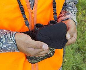 Merely fold back the top flap to quietly release the binoculars