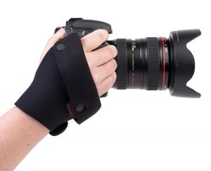 The Grip Strap™ offers a secure system for carrying an SLR camera in the hand