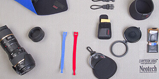 a variety of accessories laid out on a Work Mat